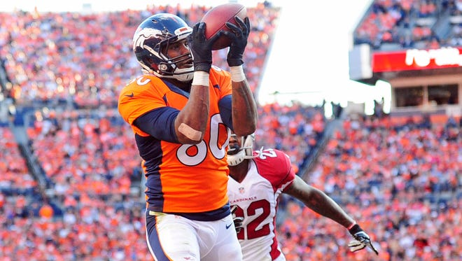Denver Broncos tight end Julius Thomas (80) pulls in a touchdown reception past Arizona Cardinals strong safety Tony Jefferson (22) in the fourth quarter at Sports Authority Field at Mile High.