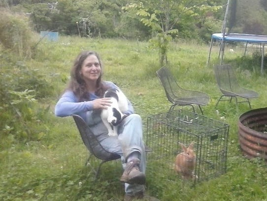 Cathy Guthrie with a cat and a rabbit.
