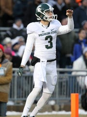 Michigan State punter Mike Sadler watches his kick against the Penn State on Nov. 29, 2014.