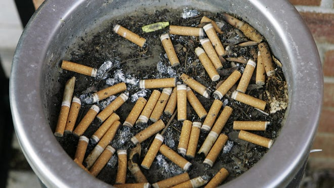 In this 2007 file photo, an ashtray full of cigarette butts is shown in Omaha, Neb.