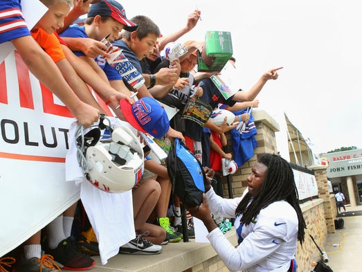 Bills rookie star receiver Sammy Watkins signs autographs for young fans after practice.