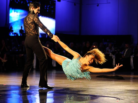 Deidre Stockard gets twirled by her dance partner,