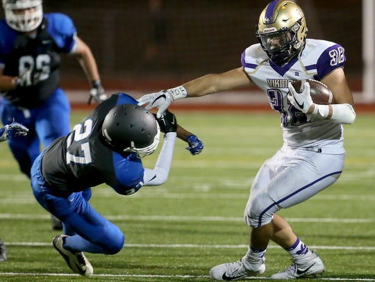 North Kitsap's Dax Solis set a school record with 1,944 rushing yards for the football team this fall.