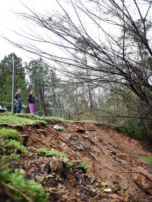 Heavy rains in November caused a landslide at the rear of Southern Pines Animal Shelter's property to threaten the building where about 40 dog runs were housed. Work is underway to fix the problem.