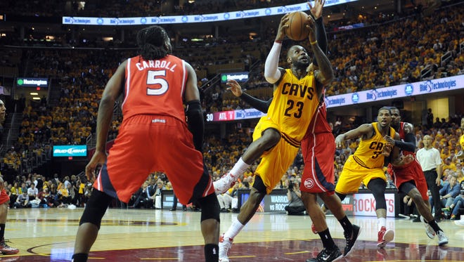 Cleveland Cavaliers forward LeBron James shoots the ball against Atlanta Hawks forward Mike Scott (32) during the second quarter in Game 4 of the Eastern Conference Finals on May 26.