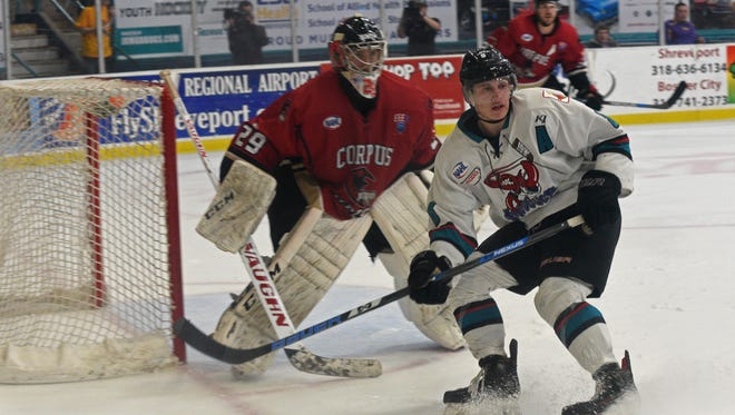 The Shreveport Mudbugs and Corpus Cristi IceRays in first period action during their playoff game Saturday evening in Shreveport.