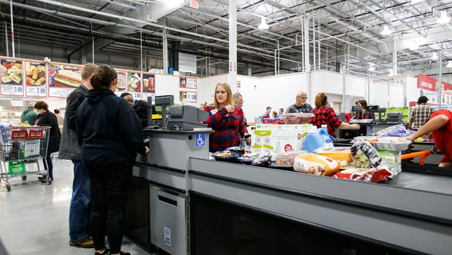 Hundreds went to East Lansing Costco early Friday morning, Oct. 27, 2017, for the grand opening of the wholesaler's store in Meridian Township.