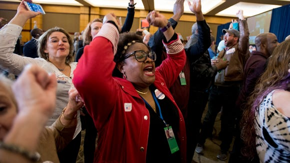 Lisa McNair, sister of one of the four girls killed in the 1963 church bombing, cheers as U.S. Senate candidate Doug Jones is declared the winner at his watch party in Birmingham, Ala. on Tuesday December 12, 2017.