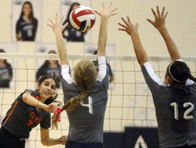 Emily Perez, left, of El Paso High goes up fort a kill