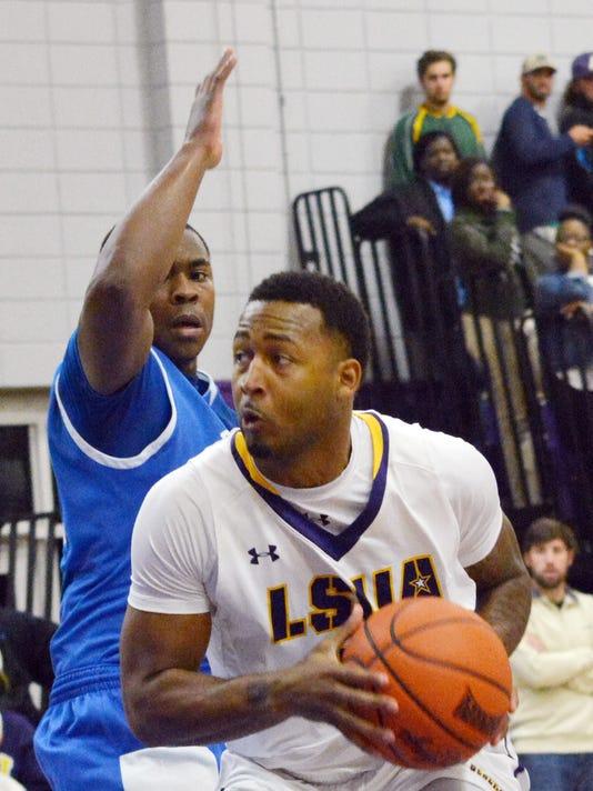 ANI LSUA Basketball LSUA's Darryl Milburn (5, front) looks to pass against Dillard Wednesday, Nov. 13, 2014.-Melinda Martinez/mmartinez@thetowntalk.com, The Town Talk, Gannett