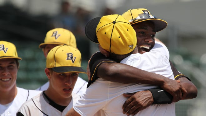 Bishop Verot's Michael Green, right, celebrates the team's win over Jacksonville Providence in the Class 4A baseball state semifinal on Friday, May 13, 2016, at JetBlue Park in Fort Myers.