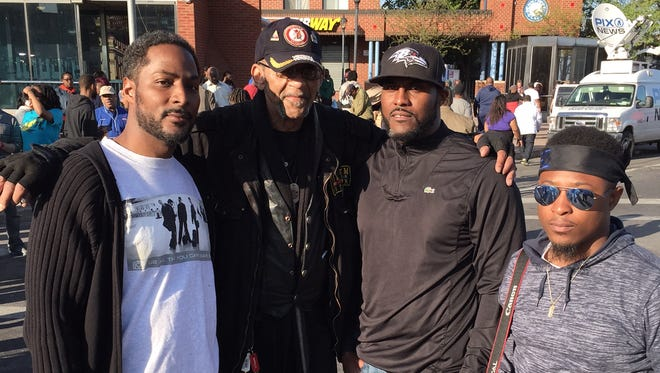 Head Dover football coach Dante Jones (left) protested Tuesday in Baltimore, along with Vietnam War veteran Robert Valentine, his brother Darrell Jones and nephew Dionta Cox.