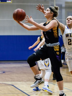 New Berlin Eisenhower junior Julia Hintz (4) drives in for a layup during the game at New Berlin West on Tuesday, Jan. 23, 2018.