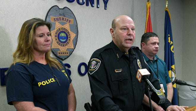 Chief Deputy Lee Tramel, center, with the Knox County Sheriff's Department, announced Wednesday, Feb. 28, 2018, that two men were arrested for buying beer, champagne, meat, seafood, EBT cards and dog food from an undercover sheriff's deputy with the Organized Crime Unit. Tramel said Joseph Cofer, 55, and Willie Hereford, 67, turned the stolen merchandise into cash that was used to fund the opioid crisis. At left is Julie McMillan, with USDA Inspector General, and right is Jeff Troxell with Tennessee Human Services Department.