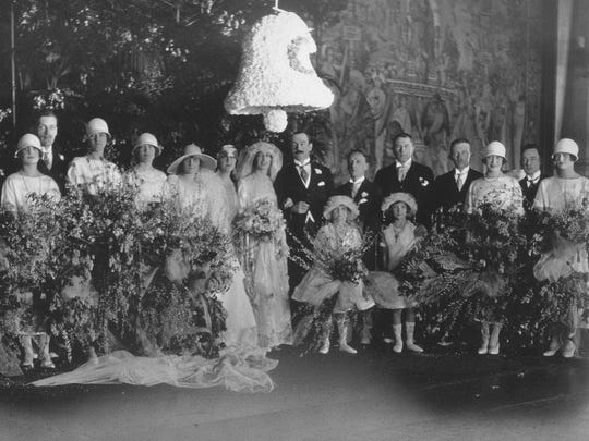 The Vanderbilt-Cecil wedding party poses for a photo in the Biltmore Tapestry Gallery.