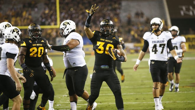 ASU defensive back Dasmond Tautalatasi (30) celebrates blocking a punt then recovering the ball against Colorado at Sun Devil Stadium in the first half on Oct. 10, 2015 in Tempe, AZ.
