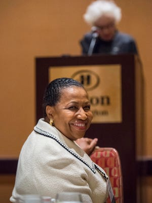 Carol Moseley Braun, the first African-American woman elected to the U.S. Senate, smiles as she is introduced by former Vermont Gov. Madeleine Kunin before speaking at a conference sponsored by the Greater Burlington Multicultural Resource Center in Burlington on Monday.
