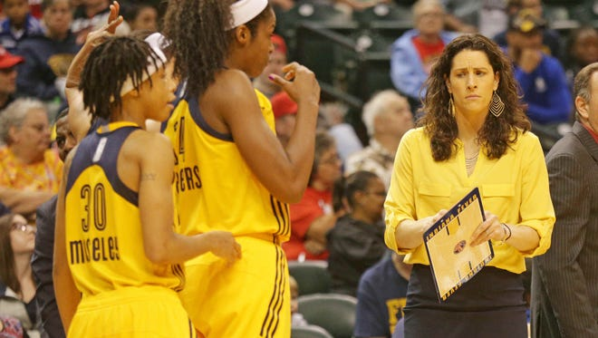 Indiana Fever Head Coach Stephanie White chats with players during a time out as the Indiana Fever play the Atlanta Dream at Bankers Life Fieldhouse, Friday May 20th, 2016. The Fever beat the Dream 94 to 85.