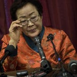 Lee Yong-soo pauses during a news conference by the Washington Coalition for Comfort Women Issues on Capitol Hill April 23, 2015 in Washington, DC. Lee Yong-soo, a Korean national, was the victim of sex crimes by Japanese military during World War II.