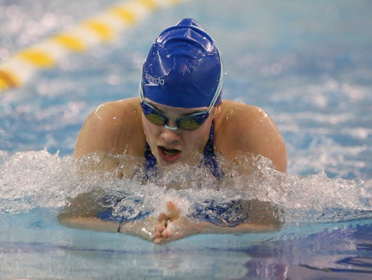 Newark Charter junior Emma Menzer pushes to victory in the 100-yard breaststroke at the DIAA Swimming and Diving Championships on Feb. 24.