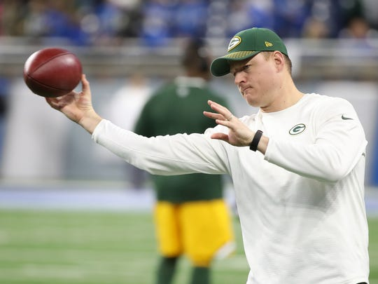 Green Bay Packers receivers coach Luke Getsy, headed to a job with Mississippi State after the season, warms up Randall Cobb before the game against the Detroit Lions on Dec. 31, 2017, at Ford Field in Detroit.