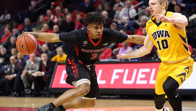 Rutgers Corey Sanders drives on Mike Gesell of Iowa during the first half, Thursday, January 21, 2016, at the Louis Brown Athletic Center in Piscataway.