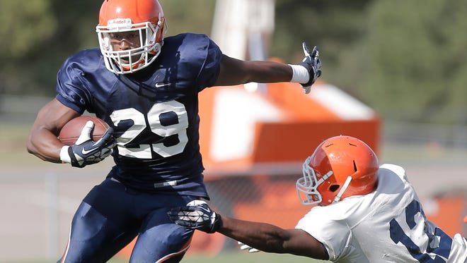 UTEP running back Aaron Jones avoids defensive back Adrian Hynson as he tries to break for a touchdown during the team's scrimmage Tuesday at Camp Ruidoso.