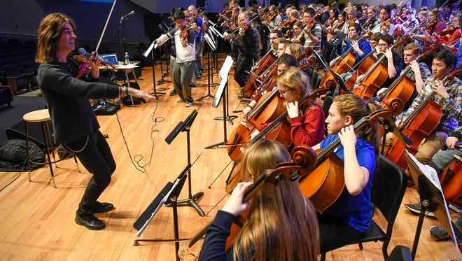 Emmy-winning composer and renowned violinist Mark Wood works with about 152 musicians from area schools Friday, Jan. 12, at Ritsche Auditorium.