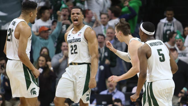 Michigan State guard Miles Bridges celebrates with teammates after hitting the game winning shot against Purdue during second half action Saturday, February 10, 2018 at the Breslin Center in East Lansing.