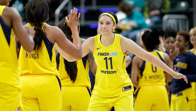 Indiana Fever forward Natalie Achonwa (11) high-fives her teammates following their WNBA preseason basketball game against the Chicago Sky at Bankers Life Fieldhouse on Monday, May 7, 2018. The Indiana Fever defeated the Chicago Sky 79-65.