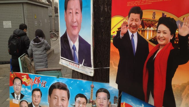 China Dreaming. Communist Party leader Xi Jinping, and army singer wife Peng Liyuan, dominate Chinese lunar New Year calendars and posters at a shop in central Beijing close to the Communist Party leadership compound from which Xi Jinping [pronounced Shee Gin Ping] rules all China.