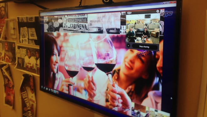 Food engagement editor Michele Marcotte, food and drink reporter Megan Wyatt and audience analyst Casey Ardoin participate in a virtual wine tasting of Carinena region wines on March 12 in Lafayette.