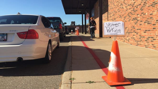 A voter heads to the polls on Tuesday at Westwood Elementary school in St. Cloud.