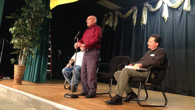 David Markovic, 96, speaks to students at Orangewood Elementary School Monday about surviving the Holocaust. He is joined on stage by his grandson, Adam, on left, and son Steven, on right.