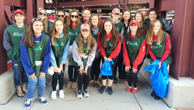 Our Lady of Mercy Academy softball players and alumnae who participated in the Phillies Red Goes Green Team are: (front row, from left) Hope Viviani of Wenonah, Madison Hagerty of Vineland, Dayne Aulffo of Minotola, Ashleigh Burrichter of Clayton, Morgan Hagerty of Vineland, Courtney Mosley of Millville; and (back row, from left) Eleana Anglani of Milmay, Tori Smith of Blackwood, Morgan Lopergolo of Vineland, Emily Myers of Hammonton, Dana Durham of Millville, Annalise Barrette of Richland, Bella Knapp of Vineland; and alumnae Emma Durham, Caitlyn Martinelli and Gianna Anglani.