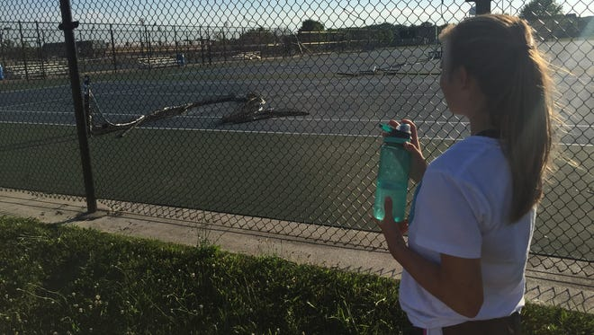 """We went to the Lafayette Jeff tennis courts Monday evening to see what was left after a driver barreled through the school's tennis courts that morning. The fence was back up, but the courts were a mess. Our daughter, Olivia, was there that morning: """"It happened just like that, Dad."""""""