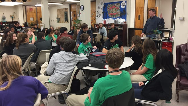 Students in Christine McCrory's AP government and politics class at Lafayette High listen to State Rep. Jean-Paul Coussan on Monday.
