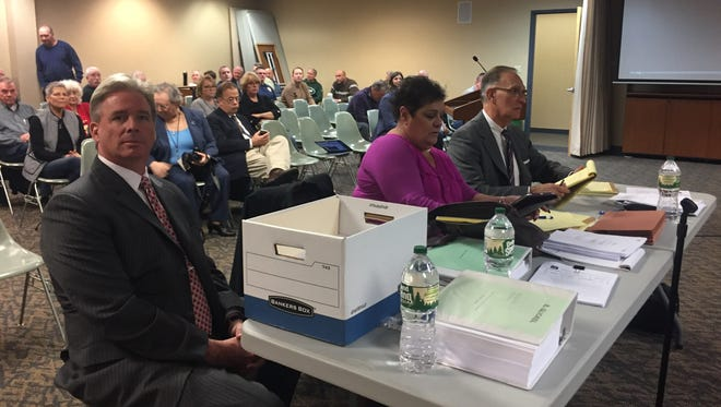 Suspended Clarkstown Police Chief Michael Sullivan sits with his lawyer Richard Glickel, far right, during the second day of disciplinary hearings in Clarkstown Town Hall.