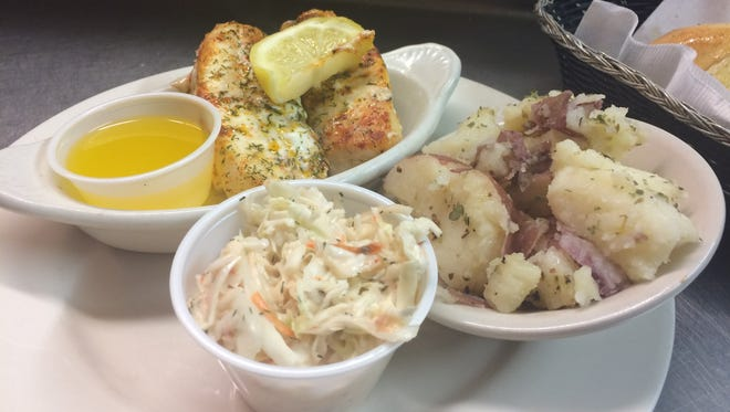 Baked haddock with potatoes and coleslaw at The Ridges Golf Course.