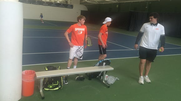 Logan and Judd Blair talk with Sprague coach Uriah Jones on Thursday at the OSAA Class 6A tennis state tournament.