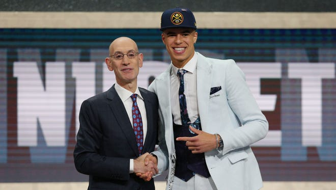 Michael Porter Jr. greets NBA commissioner Adam Silver after being selected as the No. 14 overall pick to the Denver Nuggets in the first round of the 2018 NBA draft.