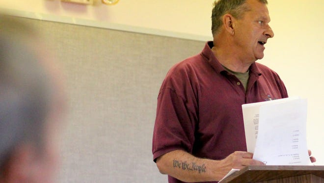 Columbus resident Mark Reshel speaks out during Wednesday's Villiage of Columbus Council Meeting. The regular meeting held an agenda item discussing the validity and legality of a sign in the village allowing for sanctuary for immigrants at a resident's home.