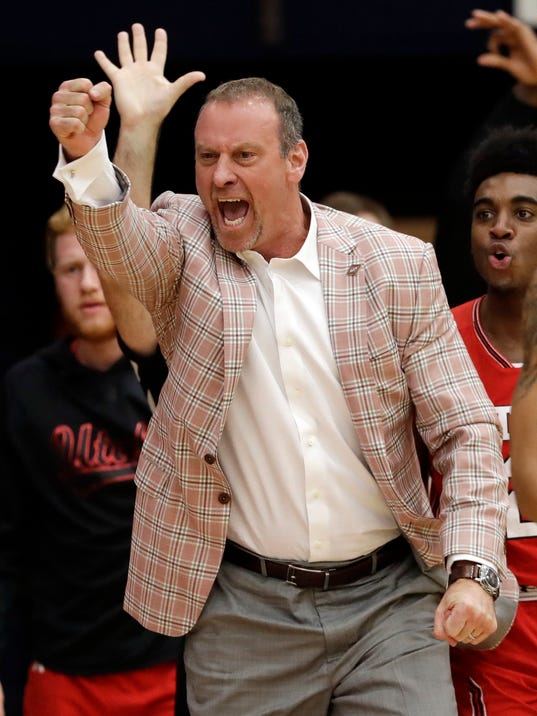 Utah coach Larry Krystkowiak reacts after a 3-point basket by Tyler Rawson during the second half of the team's NCAA college basketball game against Saint Mary's in the quarterfinals of the NIT, Wednesday, March 21, 2018, in Moraga, Calif. (AP Photo/Marcio Jose Sanchez)