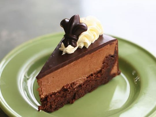 The gluten-free, flourless chocolate cake is one of the regular offerings at Indulge Dessert Lounge.