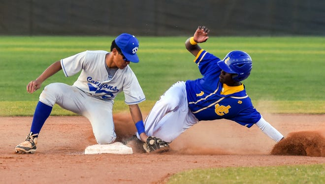 John Carroll Catholic's Jay Allen (right) steals second base before Somerset Canyons' Joe Phan can tag him out Friday, Mar. 16, 2018, during their high school baseball game at the Bob Gladwin Baseball Complex in Fort Pierce. To see more photos, go to TCPalm.com.