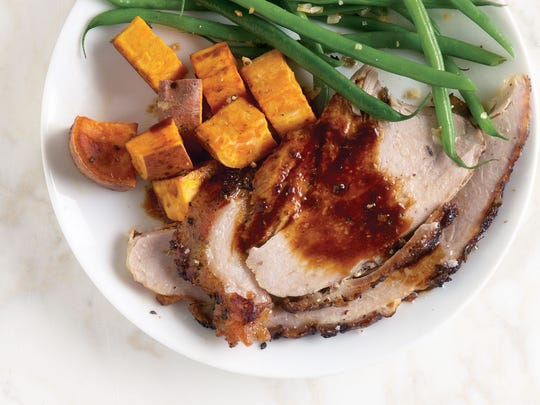 Serve roasted fresh ham — one that's never been cured or smoked — with green beans and butternut squash.