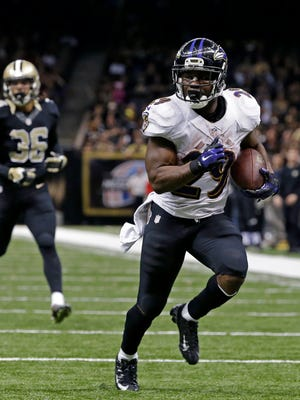 Baltimore Ravens running back Justin Forsett runs for a touchdown ahead of New Orleans Saints defensive back Marcus Ball in the second half on Monday, Nov. 24, 2014.