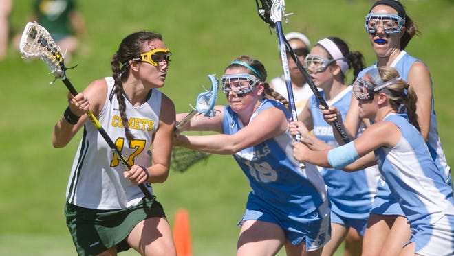 BFA-St. Albans' Leilani King, left, tries to work around the South Burlington defense during Saturday's girls lacrosse quarterfinal in St. Albans.