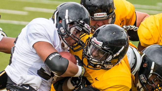 """You've got to grow up. You've got to fight it. You've got to own it as a man,"" said Jordan Lomax, right, of moving on from a hamstring injury that derailed a 2013 season in which he started as a cornerback for Iowa."