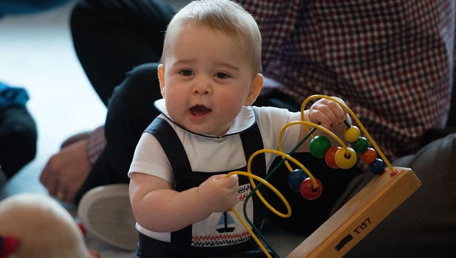 Prince George of Cambridge plays during a Plunket nurse and parents group visit at Government House on April 9, 2014 in Wellington, New Zealand.
